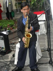 David playing his saxophone at a recent event.